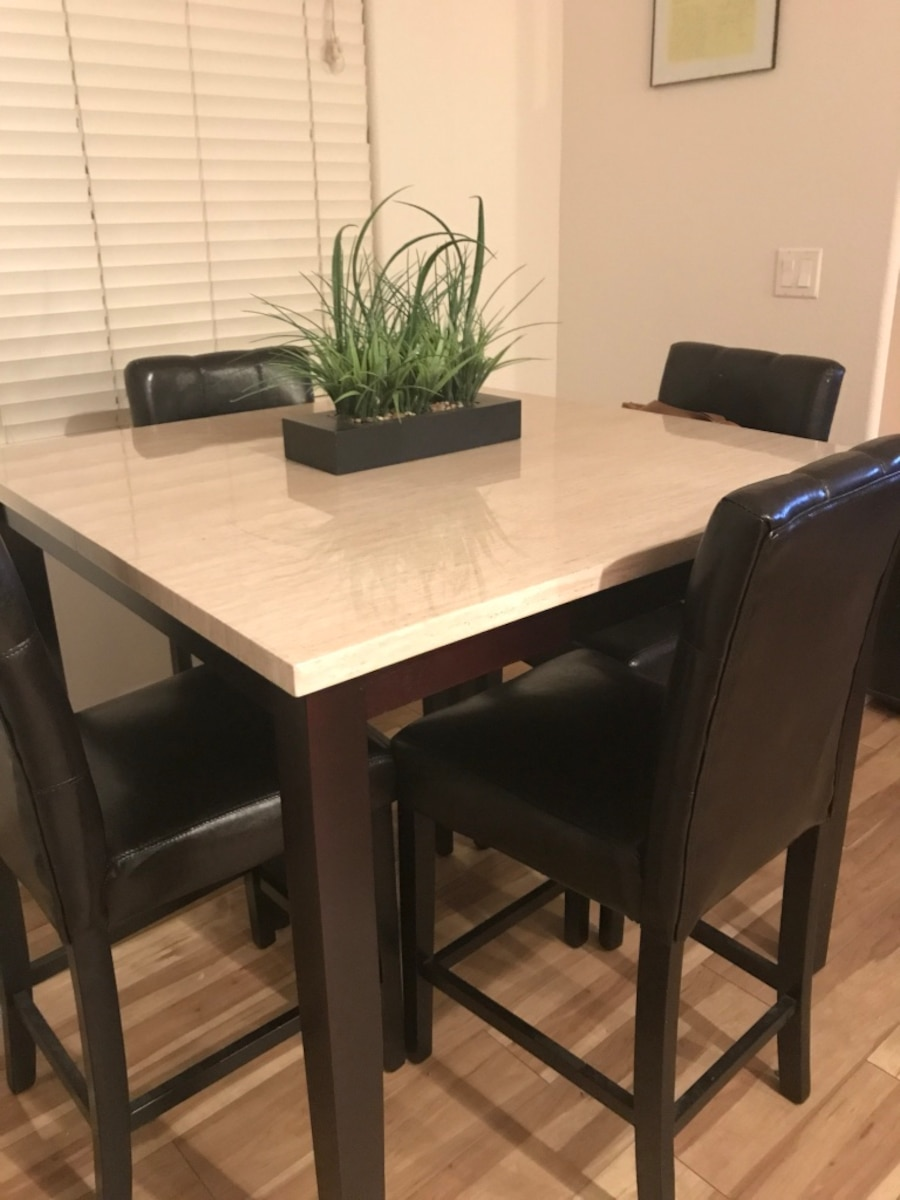 white and brown wooden table and chairs set - New River