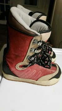 pair of red-brown-and-black lace-up boots