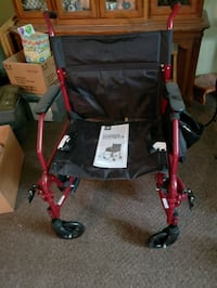 red and black wheel chair Zimmerman, 55398