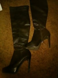 pair of black leather heeled boots Fresno, 93726
