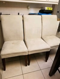 4 - Cream dining room chairs.