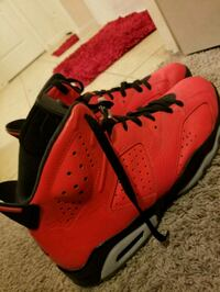 pair of red-and-black Air Jordan shoes Humble, 77338