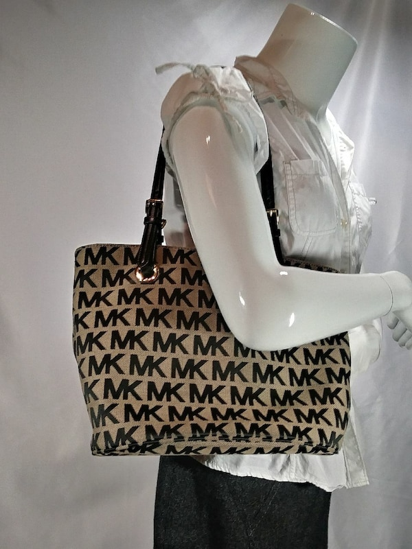 black and brown monogrammed Michael Kors shoulder bag