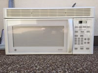 White General Electric Microwave Oven.