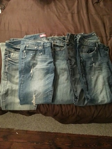 two distressed and three jeans