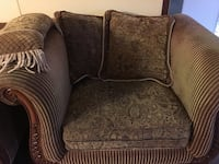 Brown and red floral fabric sofa chair and ottoman
