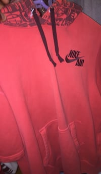red and white Nike pullover hoodie