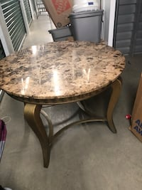 round brown marble top table with black metal base District Heights, 20747
