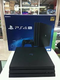 black Sony PS4 console with controller and box NEWYORK