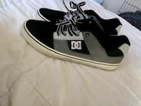 pair of black-gray-and-white DC low top shoes