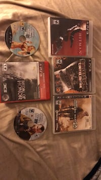 Five assorted ps3 game cases Moreno Valley