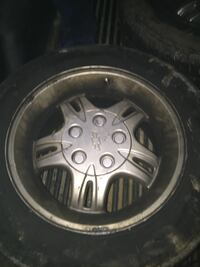 Gray 5-spoke vehicle wheel and tire Youngstown, 44505