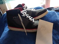 unpaired black and red Nike basketball shoe Utica