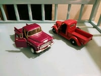 two pink and red pickup truck die-cast models