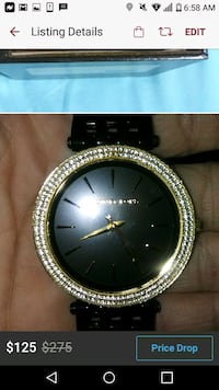 round gold analog watch with black leather strap Cleveland Heights