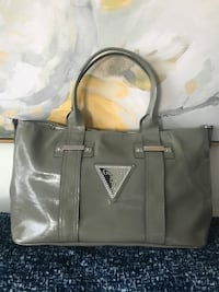 Guess bag. Like new condition. Shiny grey.
