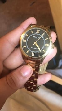 Gold Armitron watch. Ladies love it
