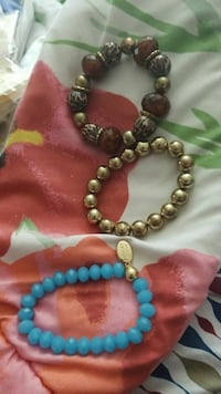 three assorted-color beaded bracelets