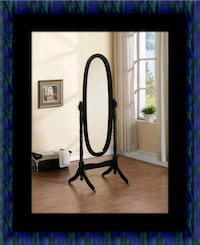 Black swivel oval mirror East Riverdale