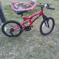 red Mongoose full-suspension bicycle