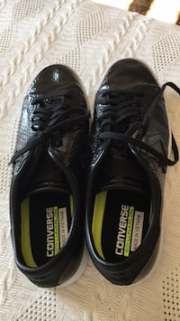 Pair of black-and-green adidas sneakers Revere, 02151