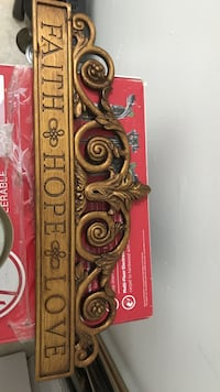 Gold-colored scroll pattern faith hope love engraved decor