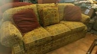 brown and beige floral fabric 3-seat sofa