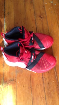 Pair of red nike basketball shoes New Haven, 06519