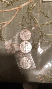 Two 2000 silver eagles coin and one 1903 Morgan dollar silver coins