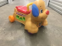 baby's yellow and red dog ride on toy