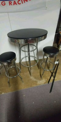 two black leather padded bar stools and table Walkersville, 21793