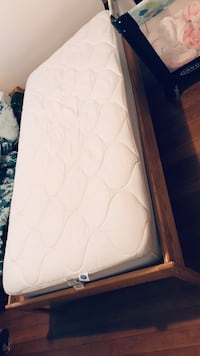 Twin wooden bed frame with mattress and barely used mattress pad!!