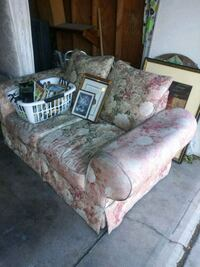brown and pink floral fabric sofa