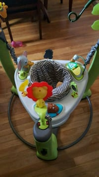 white and multicolored jumperoo Columbus