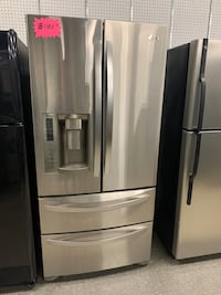 """33"""" 4 doors stainless steel refrigerator in good condition"""