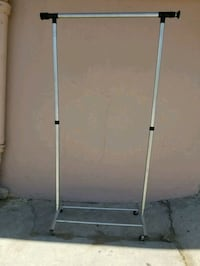 gray and white clothes rack with two plastic bags  San Diego, 92115