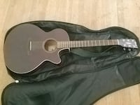 black and brown acoustic guitar North Vancouver, V7P 3A2