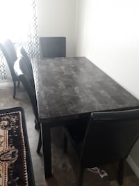 rectangular black wooden table with chairs Edmonton, T5X 2P7