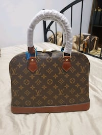 Lv alma M size, realleather suade inside shipping available thru post Toronto, M9R 0A3