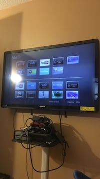 black flat screen TV with remote New York, 11206