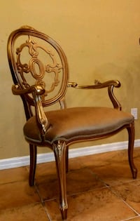 brown wooden framed brown padded armchair Estero, 33928
