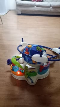 white, blue, and green activity saucer