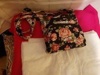 black, pink, and green floral crossbody bag