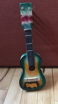 green and yellow acoustic guitar Boise, 83709