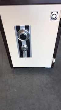 white and black wooden cabinet London, N6L 0A3