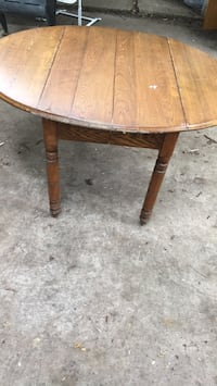 Round brown wooden pedestal table Ames, 50014
