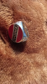 red and silver-colored Trinidad signet ring