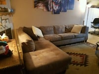 brown suede sectional sofa with throw pillows Chesapeake