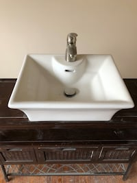 white ceramic sink with faucet 560 km