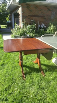 brown wooden drop-leaf table